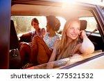 three women sitting in rear... | Shutterstock . vector #275521532
