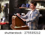 male barber standing by cash... | Shutterstock . vector #275535212