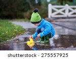 Little Boy  Jumping In Muddy...