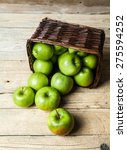 Apples In A Basket On Wooden...