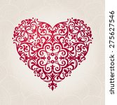 Ornate vector heart in Victorian style. Elegant element for logo design. Lace floral illustration for wedding invitations, greeting cards, Valentines cards. Vintage pink decor in shape of heart.