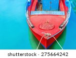 Empty Red Wooden Boat With...