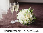 wedding glasses and bouquet | Shutterstock . vector #275693066