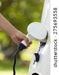 charging electric car | Shutterstock . vector #275693558