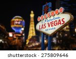 Stock photo welcome to fabulous las vegas neon sign intentional blurred las vegas strip in background 275809646