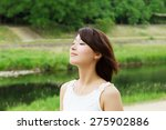 beautiful asian girl relaxing... | Shutterstock . vector #275902886