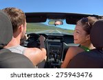 couple driving car on road trip ... | Shutterstock . vector #275943476