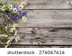 flowers on wooden background | Shutterstock . vector #276067616