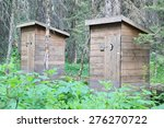 A Pair Of Wooden Outhouses In...