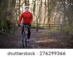 man riding mountain bike... | Shutterstock . vector #276299366