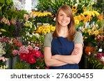 florist standing in shop in... | Shutterstock . vector #276300455