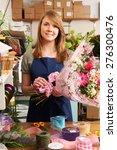 florist working on bouquet in... | Shutterstock . vector #276300476