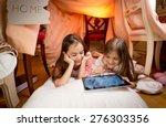 two cute girls lying on floor...   Shutterstock . vector #276303356