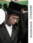 Small photo of MERON, ISRAEL - MAY 6: Young Lag Ba'omer pilgrim with long payot during the festivities May 6, 2007 in Meron. Lag Ba'omer is a Jewish holiday where thousands of Jews make pilgrimage to Meron.