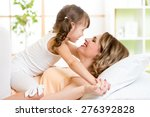 happy mother and child girl... | Shutterstock . vector #276392828