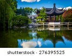 Pagoda Reflecting In A Pond At...