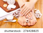 brown manicure and pedicure on... | Shutterstock . vector #276428825