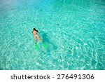 young girl snorkeling in... | Shutterstock . vector #276491306