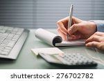 a female hand takes notes on a... | Shutterstock . vector #276702782