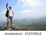 woman hiker taking photo with... | Shutterstock . vector #276759812