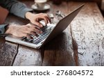 man working on a laptop on a... | Shutterstock . vector #276804572