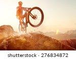 mountainbiker performs a wheelie