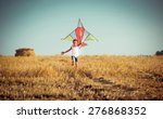 Happy Little Girl With A Kite...
