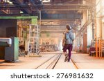 young man in a factory in... | Shutterstock . vector #276981632