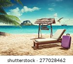 Beach Chair And Suitcase On...