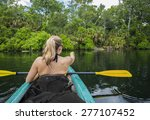 Woman Kayaker Pointing At An...