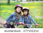 two young friends on bicycles