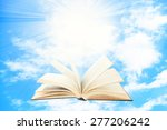 opened book on sky background | Shutterstock . vector #277206242
