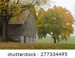 Old Barn On A Foggy Autumn Day