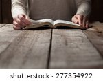Woman Reading The Bible In The...