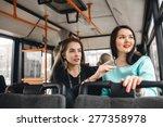 girls riding public... | Shutterstock . vector #277358978