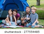 happy family in the park... | Shutterstock . vector #277554485
