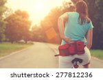 tired female cyclist stopped to ... | Shutterstock . vector #277812236