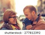 couple enjoying outdoors in a... | Shutterstock . vector #277812392
