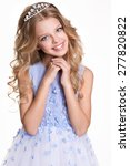 Small photo of Portrait of little girl with diadem and curly hair. Princess.