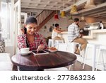 Young Woman Using Laptop In A...