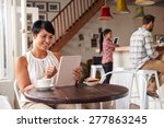 middle aged woman in a cafe | Shutterstock . vector #277863245
