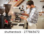 barista at work in a cafe | Shutterstock . vector #277865672
