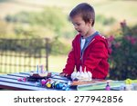 cute boy  celebrating his... | Shutterstock . vector #277942856