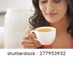 woman holding a cup of coffee | Shutterstock . vector #277953932