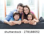 family relaxing on sofa | Shutterstock . vector #278188052