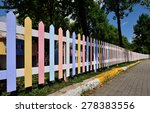 Wooden Fence Painted In Bright...