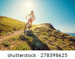 man on a mountain bike races... | Shutterstock . vector #278398625