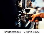 closeup of barista grinding... | Shutterstock . vector #278456522