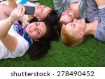 four young women lying on green ... | Shutterstock . vector #278490452