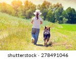 Stock photo little girl with dog walking on the road 278491046